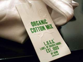 A price tag of a clothing item by H & M made of sustainably grown organic cotton.