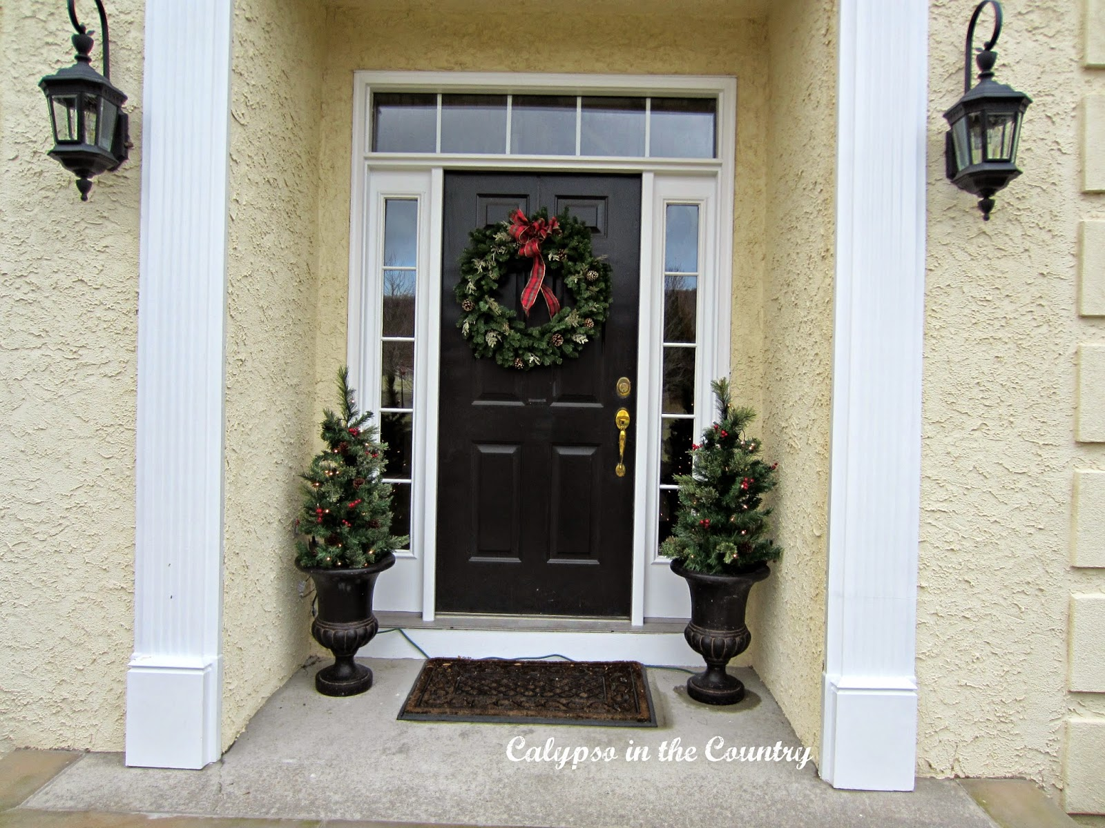Christmas Front Porch with black urns