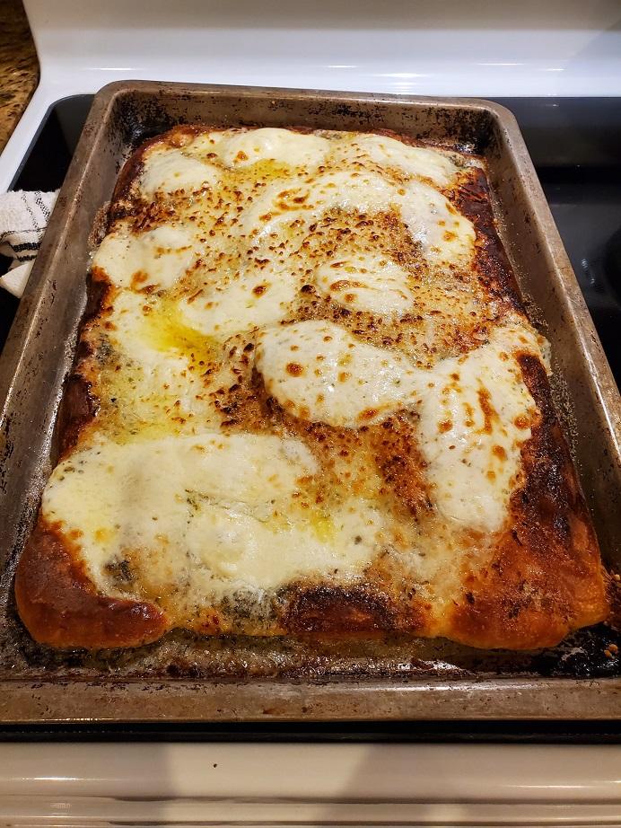 garlic pizza in rectangular form