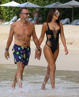 Nigora-Bannatyne-in-an-one-piece-black-swimsuit-at-the-beach-in-Barbados.-a7idk78anj.jpg