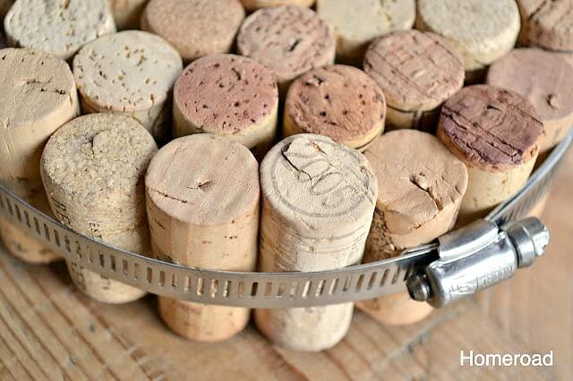 Corks glued together in a plumbers clamp.