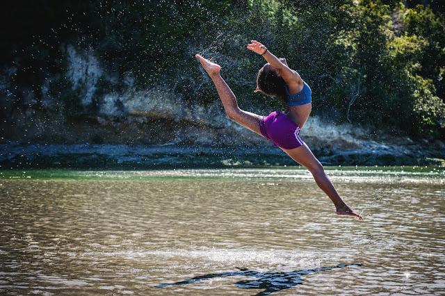 healthy woman dancing in the water