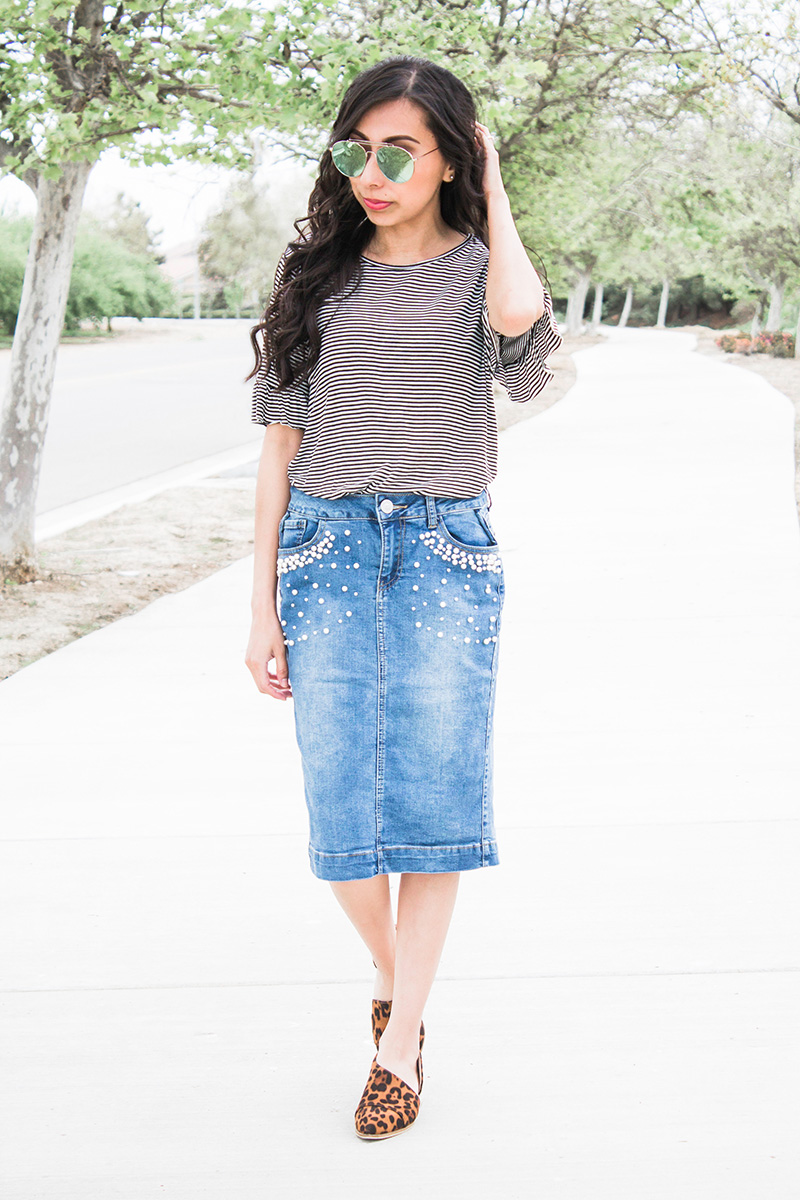 striped top with pearl denim skirt and leopard cut out booties
