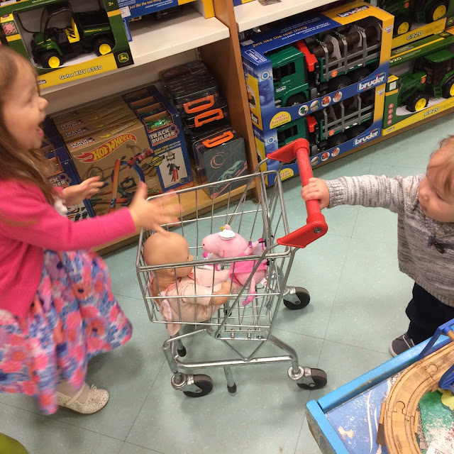 girl, boy and grocery cart in store