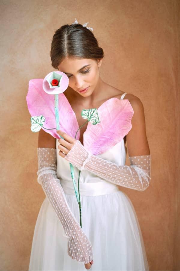 large paper flower arrangement held by bride