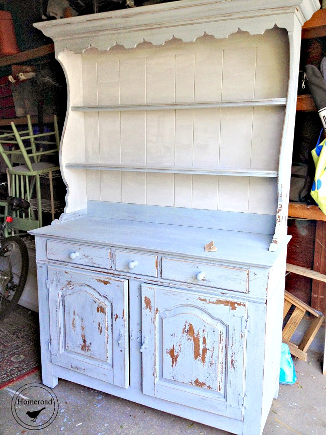 Painted hutch with white interior and light blue background