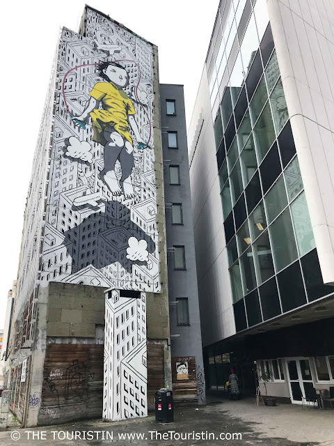 Mural skipping girl, created during Street Art Festival on a high rise in Bratislava in Slovakia