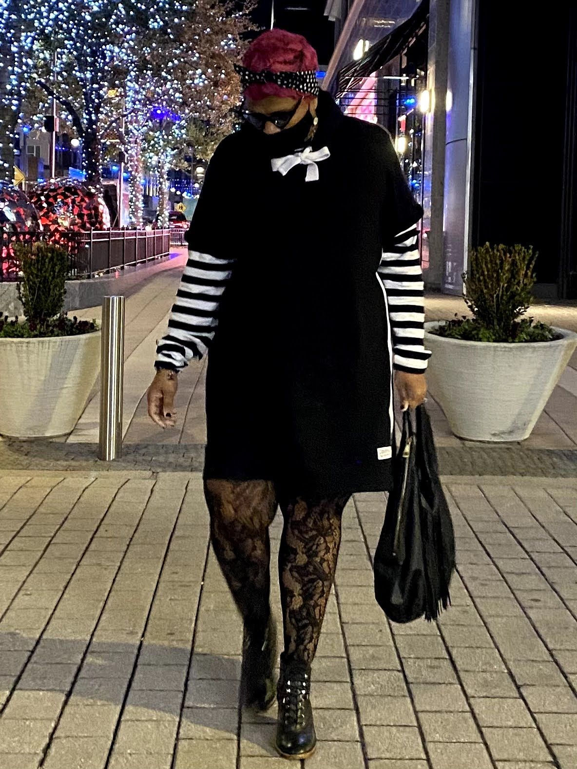 Tangie Bell showing off her black and white outfit for date night