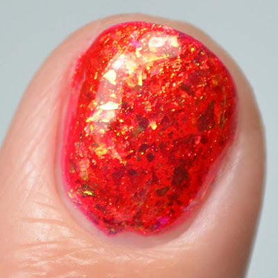 red flakie nail polish close up swatch