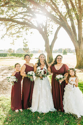 bride with bridesmaids in burgundy