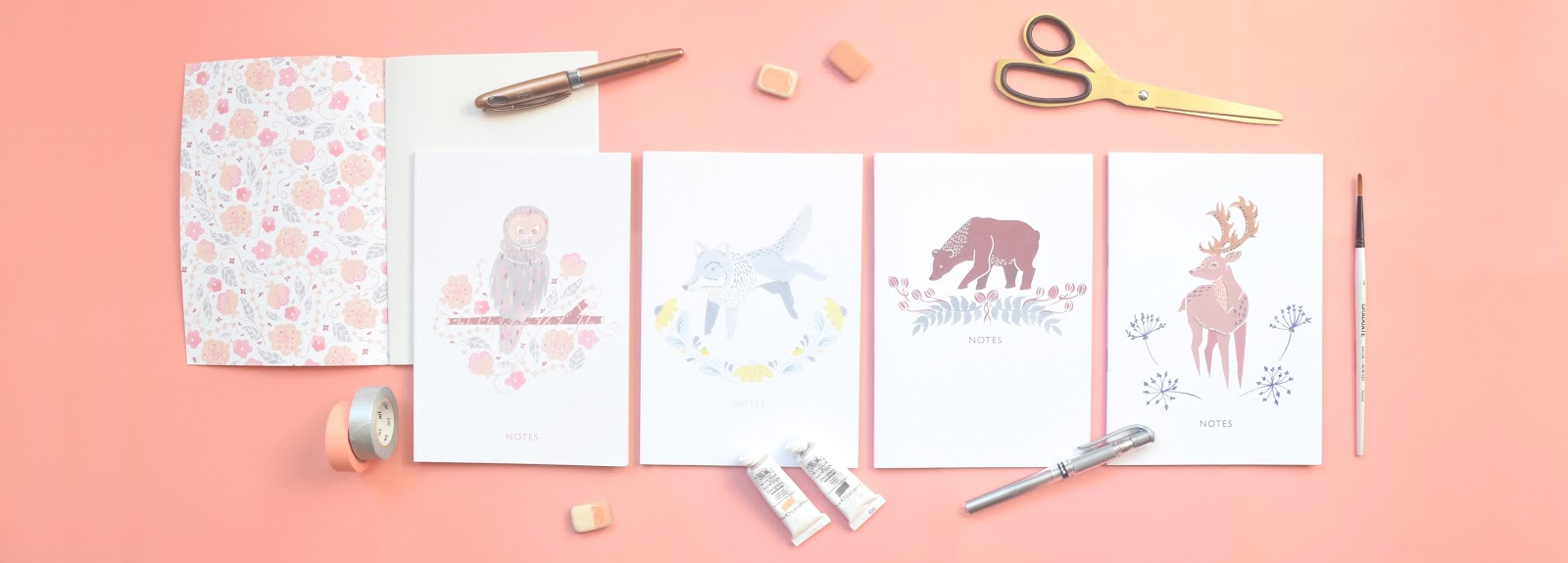 illustrated animal notebooks flat lay