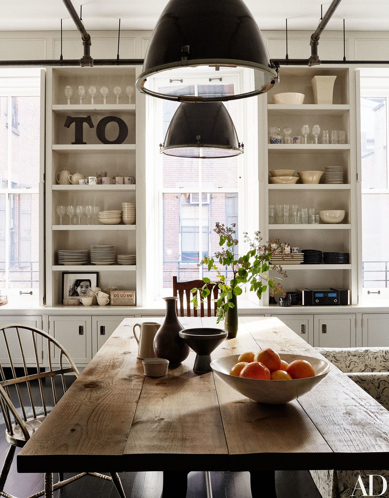 Magnificent industrial farmhouse kitchen wih white builtin shelves and farm table #modernfarmhouse #farmhousekitchen