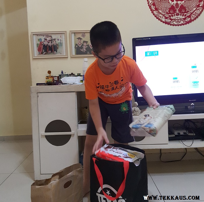 Boy Unwrapping His Birthday Gifts