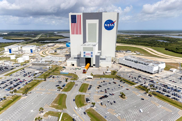 An aerial view of the SLS core stage booster for Artemis 1 being transported into the Vehicle Assembly Building at NASA's Kennedy Space Center in Florida...on April 29, 2021.