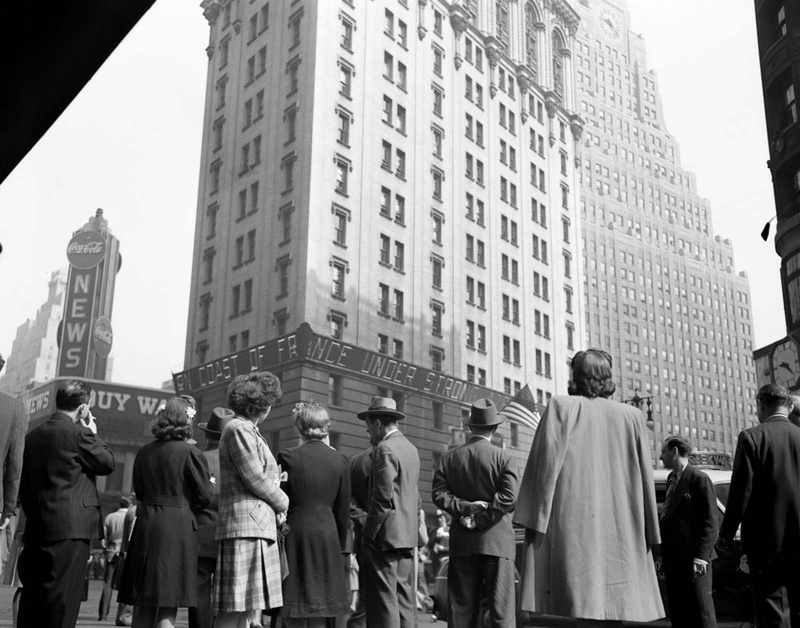 Crowds watching the electronic ticker on the New York Times building in Times Square as they waited for the latest reports.