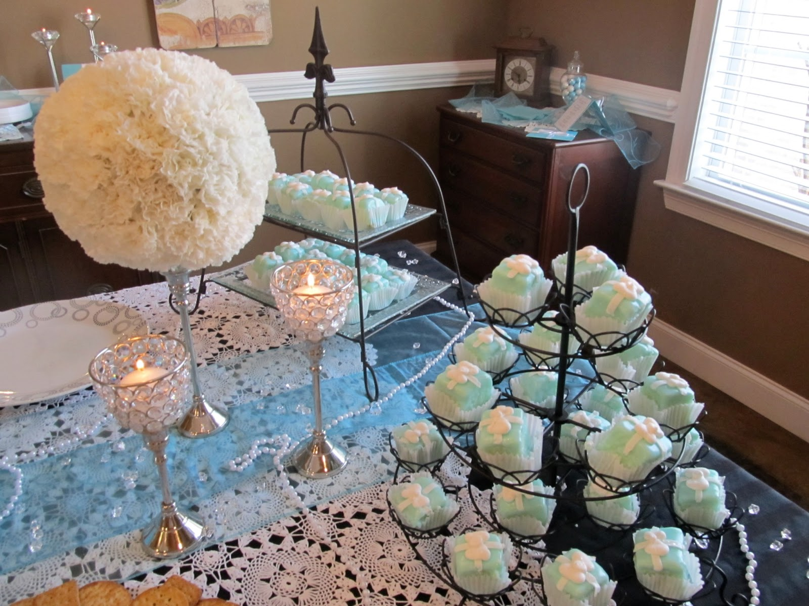 860c02e4ed The lovely ladies at Rick's Bakery were able to customize the glaze to  match the Tiffany blue color and added sweet little buttercream bows to the  ...