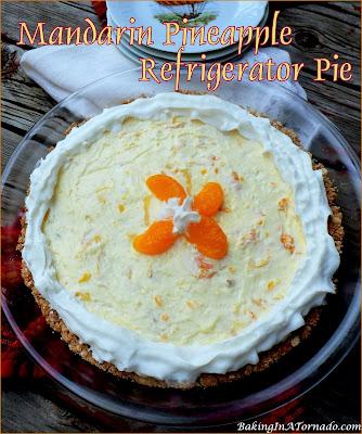 Mandarin Pineapple Refrigerator Pie, a tropical flavored, easy, creamy, fruit studded, no-bake pie. | recipe developed by www.BakingInATornado.com | #recipe #dessert