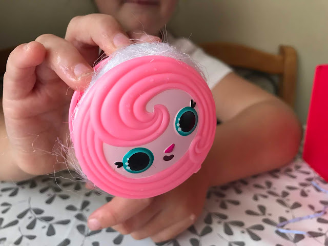 pink animal face roller with pop pop hair hidden inside