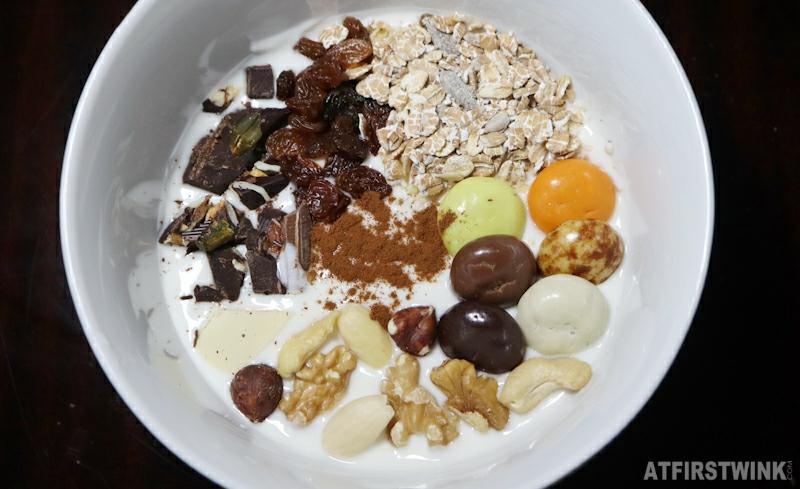 not so healthy yogurt bowl with leftover Sinterklaas chocolate pepernoten raisins oats mixed nuts cinnamon breakfast