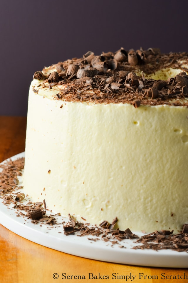 Tiramisu Angel Food Cake consists of light airy layers of angel food cake, liquor infused espresso, creamy marscapone filling, and topped with chocolate curls is a favorite dessert recipe from Serena Bakes Simply From Scratch.