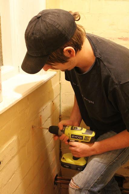 man using ryobi drill