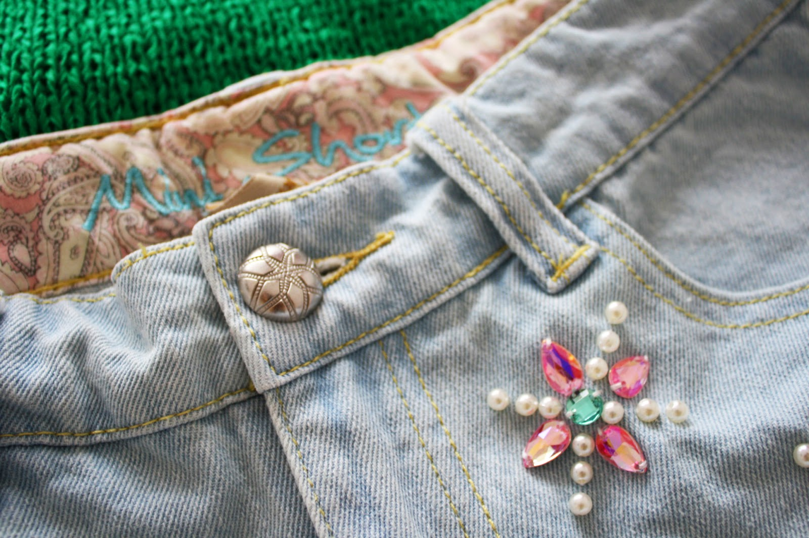 Beading & patterns on a pair of denim shorts from Primark