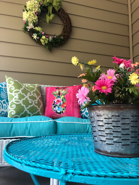 "The Chic Technique: ""Our Lilly Pulitzer-Inspired Porch."" Summer outdoor decor with bright colors and floral accents. thechictechnique.com"