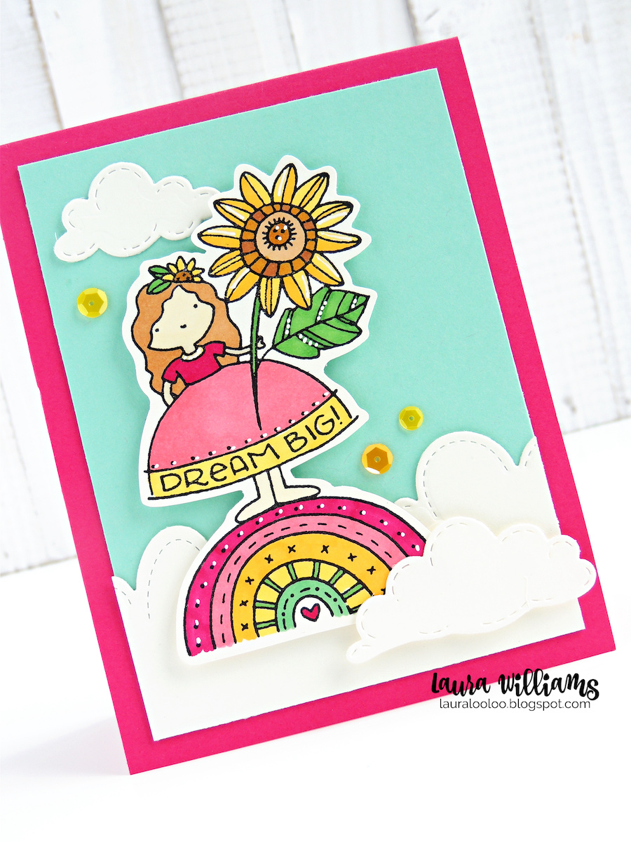 A handmade card featuring a sweet girl holding a giant sunflower, and standing on a colorful rainbow, nestled in a sea of clouds. The image was colored with alcohol markers, in warm tones of pinks, and yellows. The sky is aqua cardstock, to add contrast to the warmth of the girl, flower, and rainbow. The card base is dark pink.