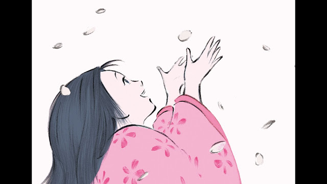 A girl with black loose hair wearing a pink Japanese kimono while enjoying a shower of petals
