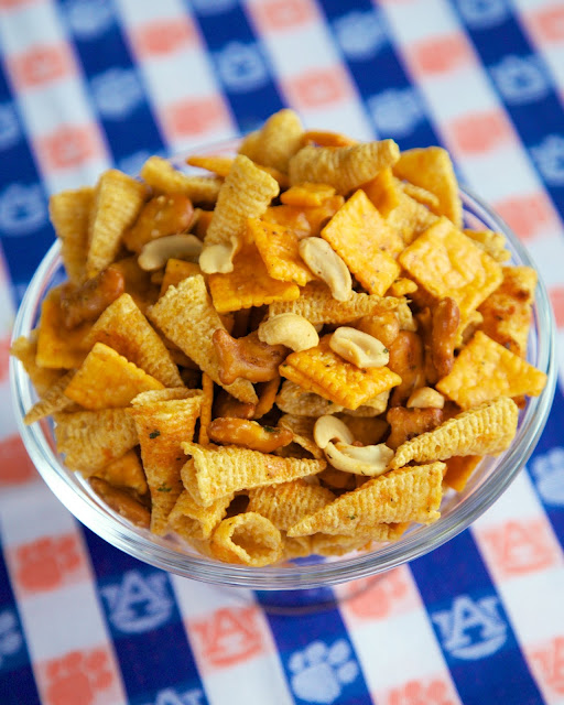 Buffalo Ranch Snack Mix - SO good! I took this to a party and it was the first thing to go. Everybody asked for the recipe!! No baking required! Bugles, Goldfish pretzels, Cheez-its, cashews, ranch dressing mix, buffalo sauce and oil. Toss together and it is ready to eat! #snack #tailgating #nobake #partyfood #appetizer
