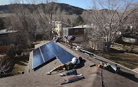 A new rate settlement in Colorado could help boost rooftop installations like this one in Boulder. (Credit: Getty Images) Click to Enlarge.