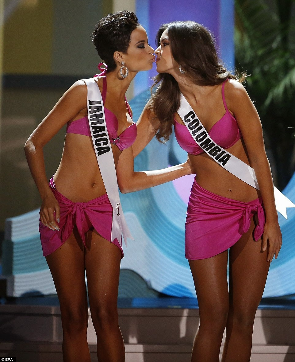 Miss Jamaica and Miss Colombia compete during the swimsuit competition before the controversial decision was announced