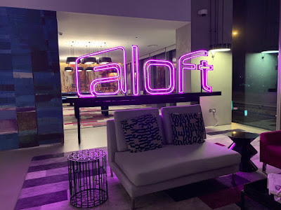 Lobby area with a neon sign