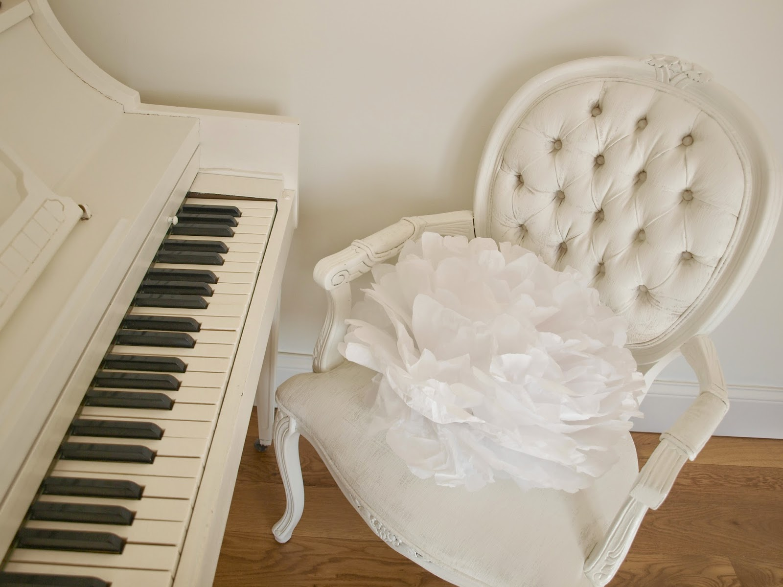 Hello Lovely Studio white piano and French chair with tissue pouf