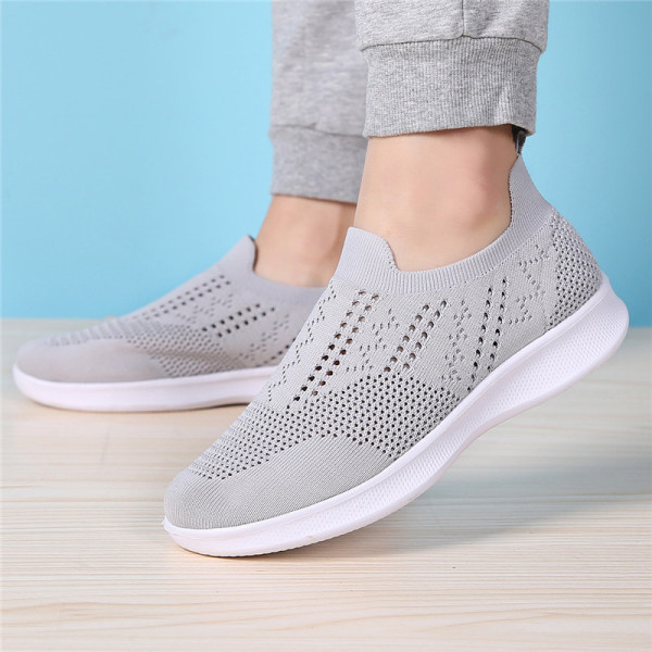 Women's soft sole flying woven sneakers