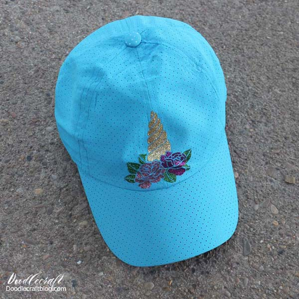 Iron on glitter vinyl Unicorn horn and flowers on baseball hat with cricut maker and easypress