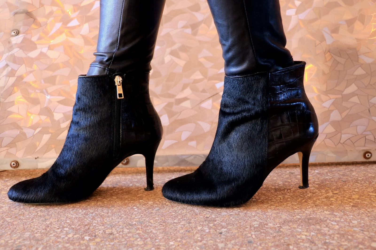 Nyc fashion blogger Kathleen Harper wearing black calf hair booties from Ann Taylor.