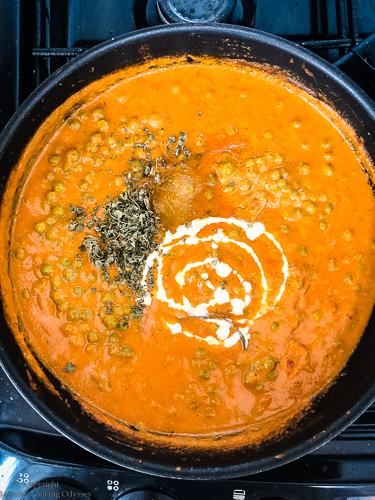 Making matar paneer step 10 cream added to the matar paneer curry