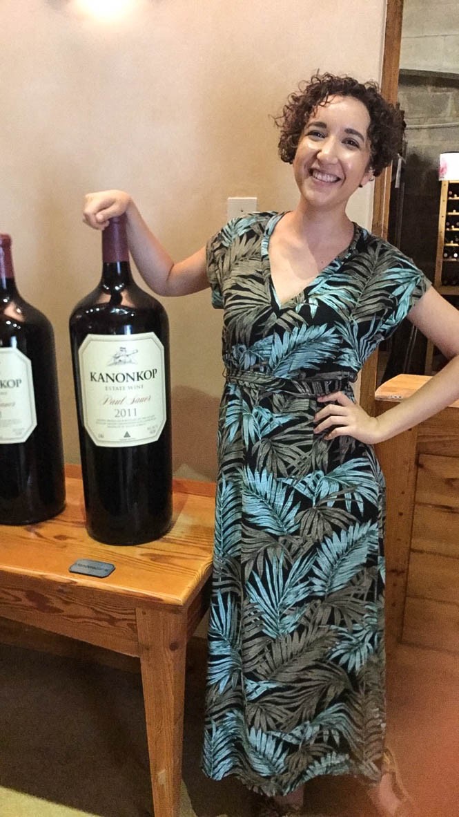 Woman with giant bottle of wine
