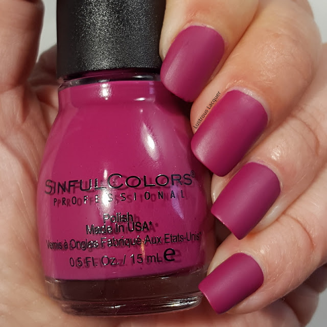 Dark berry pink colored nail polish with a matte finish