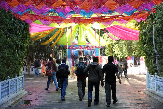 Book lovers walking through the colorful entrance of Jaipur Literature Fest