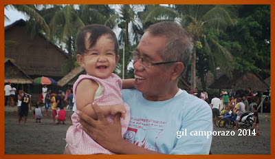 Inday Sophie laughing cuddled by her grandpa Gil