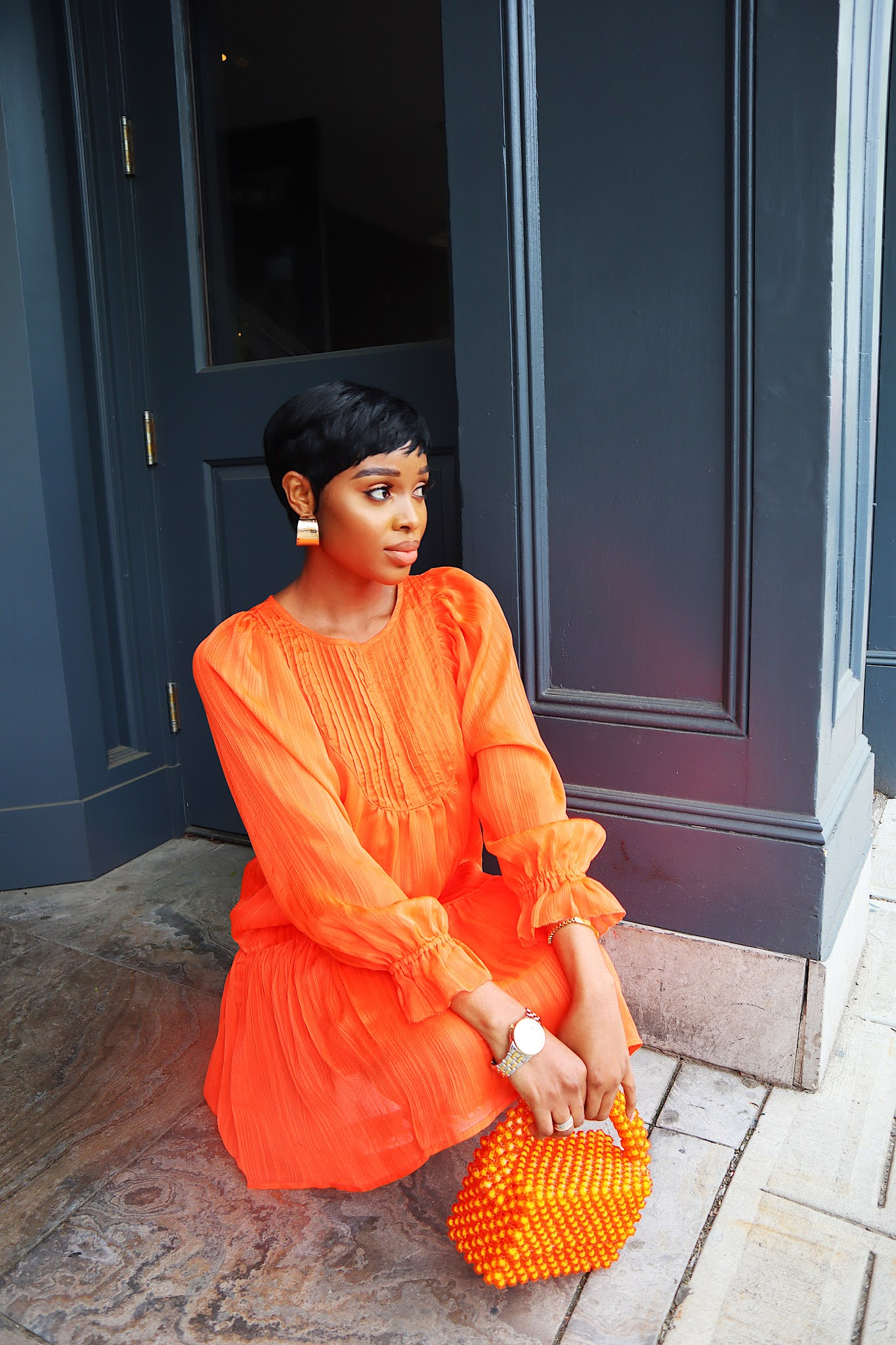 How to style an orange dress for spring