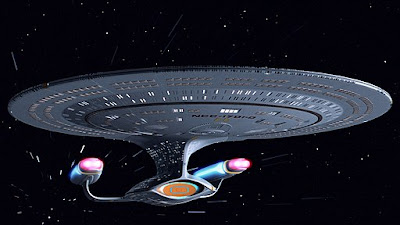 Starship enterprise moving through space.