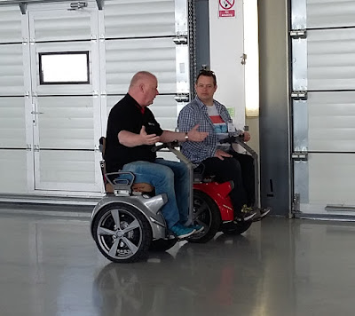 Neil and the demo guy on their segways