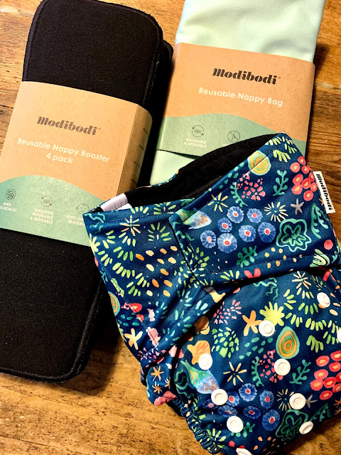 Modibodi reusable nappy plus booster liners and nappy bag.