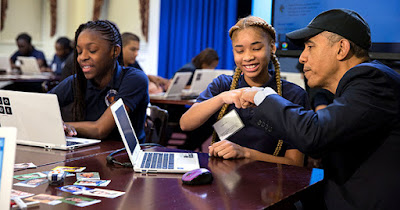 President Obama with children learning computers