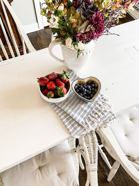 Wildflowers in white pitcher as table decor