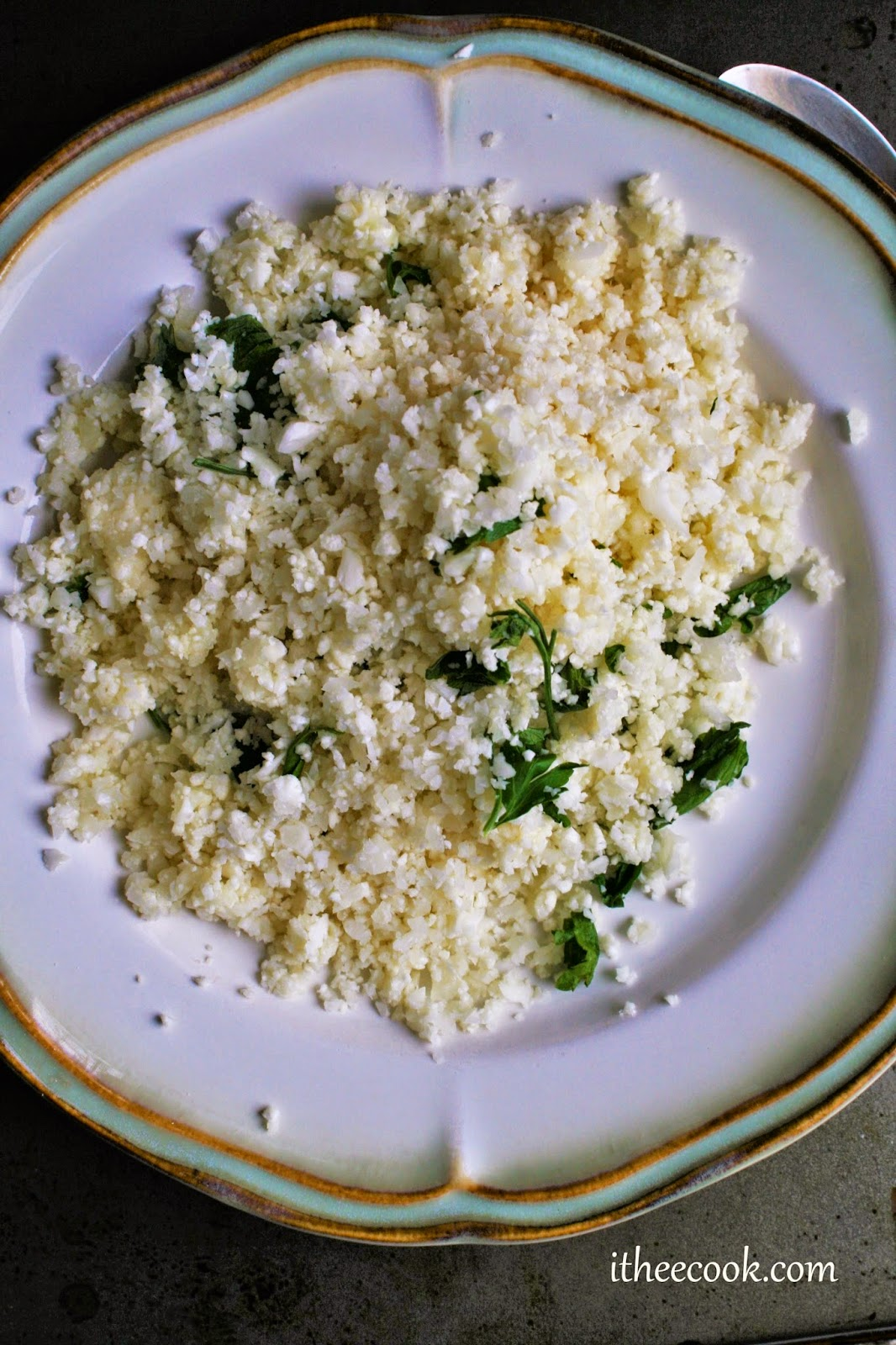 Herbed Cauliflower Rice, sauteed with fresh herbs and topped with parmesan and butter, a easy, delicious side dish!