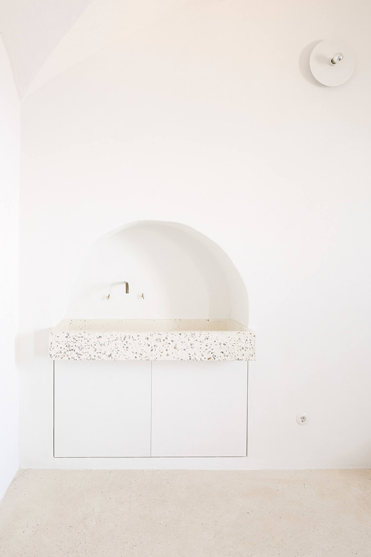 Custom-made concrete sink, brass pipe faucet, arched nook sink, renovated house in Mallorca by Isla Architects